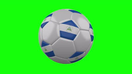 nicaraguan : Soccer ball with Nicaragua flag rotates on green chroma key background, loop Stock Footage