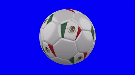mexico city : Soccer ball with Mexico flag rotates on blue chroma key background, loop Stock Footage
