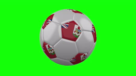 bermudas : Soccer ball with Bermuda flag rotates on green chroma key background, loop Stock Footage