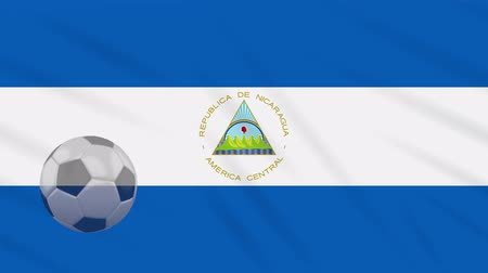 nicaraguan : Nicaragua flag and soccer ball rotates against background of a waving cloth, loop