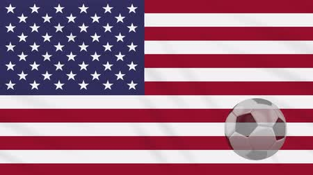 victory day : United States of America flag and soccer ball rotates against background of a waving cloth, loop Stock Footage
