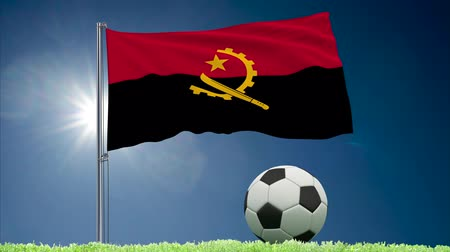 felhőtlen : Flag of Angola fluttering and soccer ball rolls on lawn, 3d rendering
