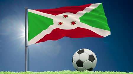 felhőtlen : Flag of Burundi fluttering and soccer ball rolls on lawn, 3d rendering