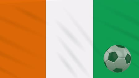 marfim : Ivory Coast - Cote dIvoire flag and soccer ball rotates against background of a waving cloth, loop