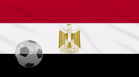 kahire : Egypt flag and soccer ball rotates against background of a waving cloth, loop