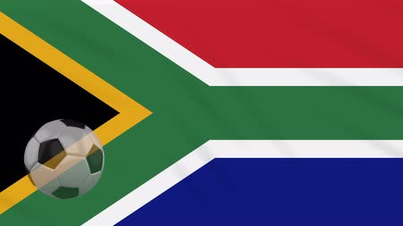 pretoria : South Africa flag and soccer ball rotates against background of a waving cloth, loop Stock Footage