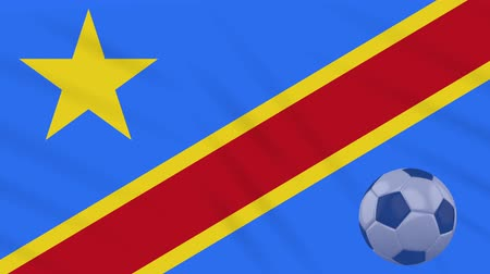 oficial : Democratic Republic of Congo flag and soccer ball rotates against background of a waving cloth, loop Stock Footage