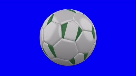 nigeria flag : Soccer ball with Nigeria flag rotates on blue chroma key background, loop