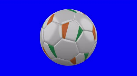 アイボリー : Soccer ball with Ivory Coast - Cote dIvoire flag rotates on blue chroma key background, loop