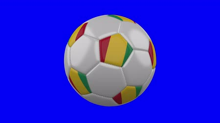 gine : Soccer ball with Guinea flag rotates on blue chroma key background, loop