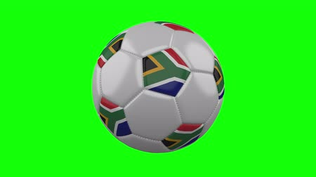 pretoria : Soccer ball with South Africa flag rotates on green chroma key background, loop