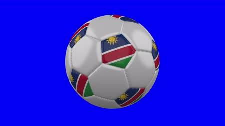 tek bir nesne : Soccer ball with Namibia flag rotates on blue chroma key background, loop Stok Video