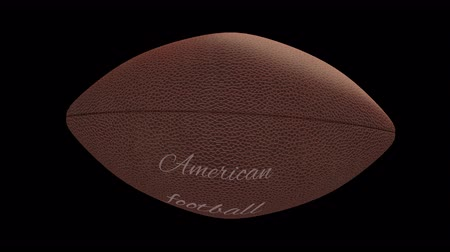 rekreace : Ball for American football with the inscription American football flies and compresses on transparent background, 4k alpha loop