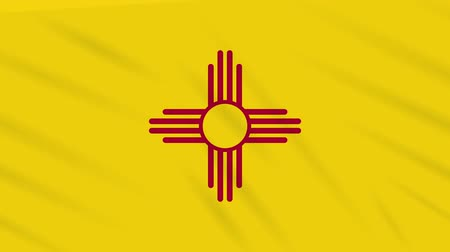 vlastenectví : New Mexico flag flutters in the wind, loop for background.