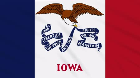 iowa : Iowa flag flutters in the wind, loop for background.
