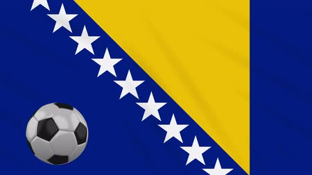 bosnia and herzegovina : Bosnia and Herzegovina flag and soccer ball rotates against background of a waving cloth, loop
