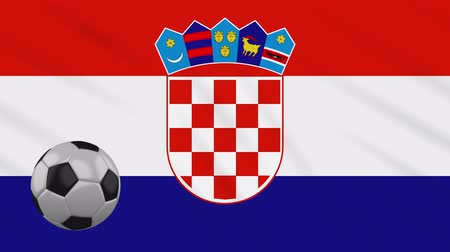 ザグレブ : Croatia flag and soccer ball rotates against background of a waving cloth, loop 動画素材
