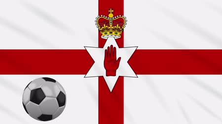 belfast : Northern Ireland flag and soccer ball rotates against background of a waving cloth, loop Stock Footage