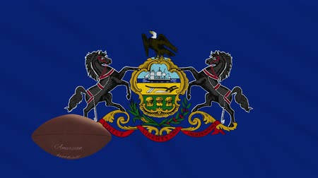 végső : Pennsylvania flag and american football ball rotates against background of a waving cloth, loop Stock mozgókép