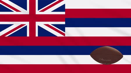végső : Hawaii flag and american football ball rotates against background of a waving cloth, loop