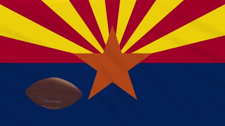 anka kuşu : Arizona flag and american football ball rotates against background of a waving cloth, loop Stok Video
