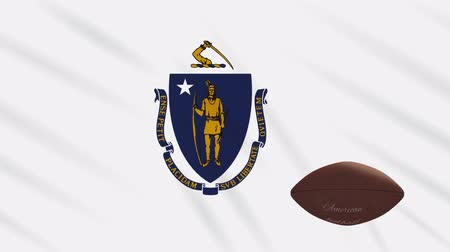 végső : Massachusetts flag and american football ball rotates against background of a waving cloth, loop Stock mozgókép