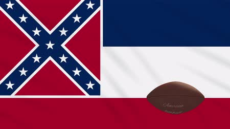 schriftzug : Mississippi flag and american football ball rotates against background of a waving cloth, loop
