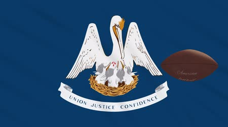 asa : Louisiana flag and american football ball rotates against background of a waving cloth, loop