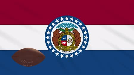 végső : Missouri flag and american football ball rotates against background of a waving cloth, loop