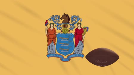 new jersey : New Jersey flag and american football ball rotates against background of a waving cloth, loop