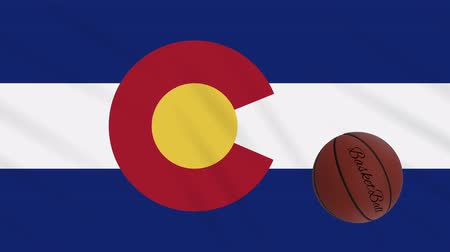 world cup : Colorado flag and basketball ball rotates against background of a waving cloth, loop Stock Footage