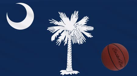 colômbia : South Carolina flag and basketball ball rotates against background of a waving cloth, loop