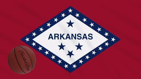 フープ : Arkansas flag and basketball ball rotates against background of a waving cloth, loop