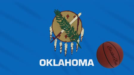 world cup : Oklahoma flag and basketball ball rotates against background of a waving cloth, loop Stock Footage