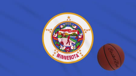abroncs : Minnesota flag and basketball ball rotates against background of a waving cloth, loop Stock mozgókép