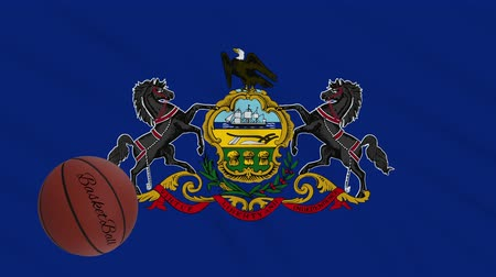 végső : Pennsylvania flag and basketball ball rotates against background of a waving cloth, loop Stock mozgókép