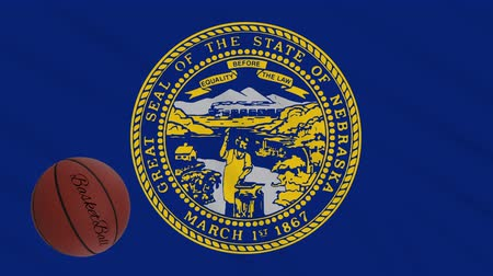 world cup : Nebraska flag and basketball ball rotates against background of a waving cloth, loop