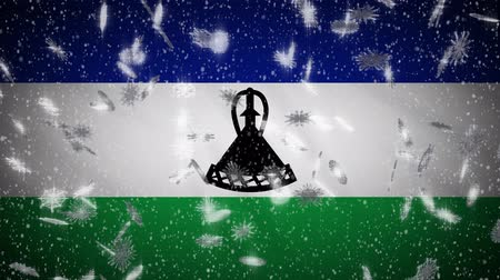 monarchy : Lesotho flag falling snow loopable, New Year and Christmas background, loop.