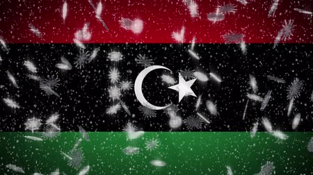 libya : Libya flag falling snow loopable, New Year and Christmas background, loop.