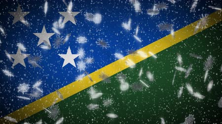 melanesia : Solomon Islands flag falling snow loopable, New Year and Christmas background, loop.