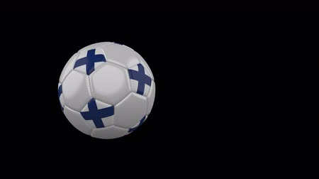 finlandiya : Finland flag on a flying and rotating soccer ball on a transparent background, 4k prores footage with alpha channel Stok Video