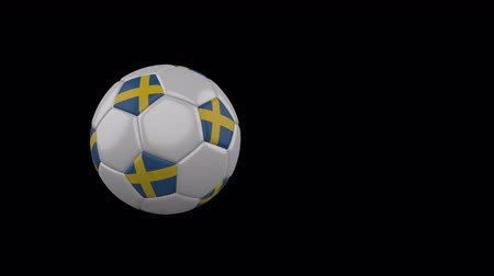 Sweden flag on a flying and rotating soccer ball on a transparent background, 4k prores footage with alpha channel