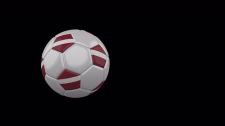 Latvia flag on a flying and rotating soccer ball on a transparent background, 4k prores footage with alpha channel
