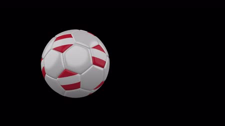 Austria flag on a flying and rotating soccer ball on a transparent background, 4k prores footage with alpha channel Стоковые видеозаписи