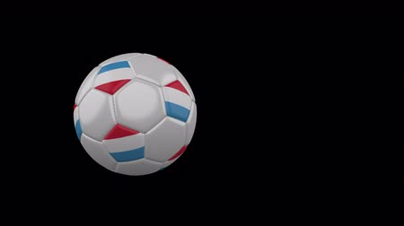Luxembourg flag on a flying and rotating soccer ball on a transparent background, 4k prores footage with alpha channel