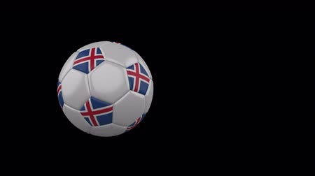 Iceland flag on a flying and rotating soccer ball on a transparent background, 4k prores footage with alpha channel Стоковые видеозаписи