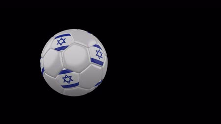 Israel flag on a flying and rotating soccer ball on a transparent background, 4k prores footage with alpha channel