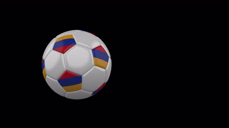 Armenia flag on a flying and rotating soccer ball on a transparent background, 4k prores footage with alpha channel Стоковые видеозаписи