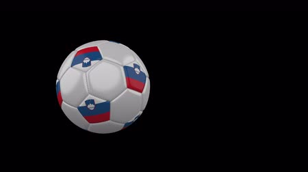 ljubljana : Slovenia flag on a flying and rotating soccer ball on a transparent background, 4k prores footage with alpha channel Stock Footage