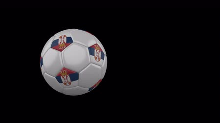 sérvia : Serbia flag on a flying and rotating soccer ball on a transparent background, 4k prores footage with alpha channel